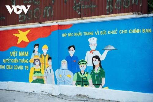 Murales de propaganda sobre la respuesta al covid-19 en Hanói - ảnh 13