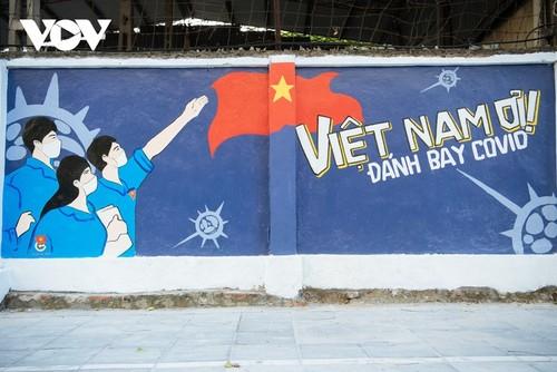 Murales de propaganda sobre la respuesta al covid-19 en Hanói - ảnh 14