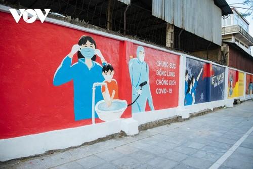 Murales de propaganda sobre la respuesta al covid-19 en Hanói - ảnh 3