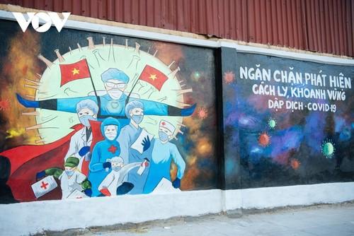 Murales de propaganda sobre la respuesta al covid-19 en Hanói - ảnh 5