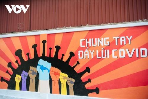 Murales de propaganda sobre la respuesta al covid-19 en Hanói - ảnh 6