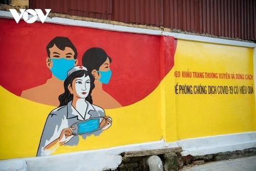 Murales de propaganda sobre la respuesta al covid-19 en Hanói - ảnh 7