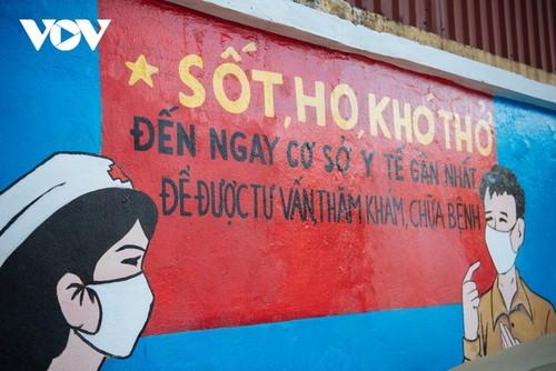 Murales de propaganda sobre la respuesta al covid-19 en Hanói - ảnh 8