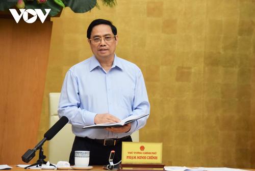 Pham Minh Chinh: protéger la santé et la vie de la population est une priorité absolue - ảnh 1