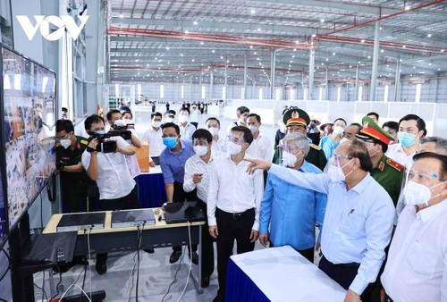 Covid-19: Nguyên Xuân Phuc travaille avec les autorités de Binh Duong - ảnh 2