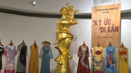 越南传统 奥黛上的越南文化遗产 - ảnh 4