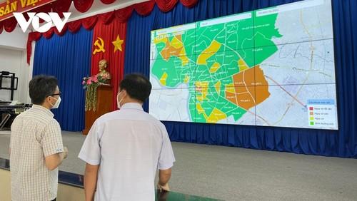 越南政府副总理武德担视察平阳省防疫工作 - ảnh 1