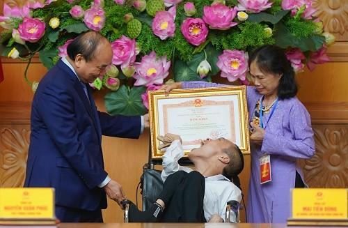 Thủ tướng Nguyễn Xuân Phúc: Lan toả tính nhân văn, sự thương yêu đùm bọc của người Việt Nam - ảnh 1
