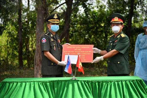 Ký kết hợp tác tìm kiếm hài cốt liệt sỹ quân tình nguyện và chuyên gia Việt Nam với Campuchia - ảnh 1