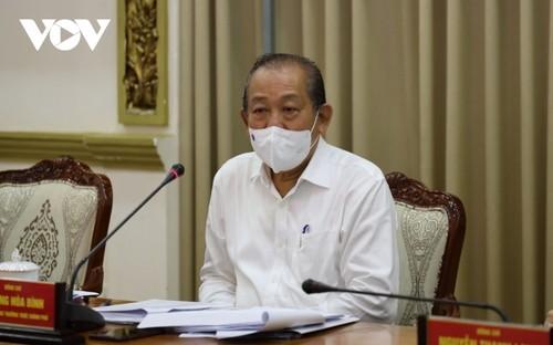 Phó Thủ tướng Trương Hòa Bình yêu cầu Thành phố Hồ Chí Minh quyết liệt phòng chống dịch bệnh, kịp thời khống chế lây lan - ảnh 1