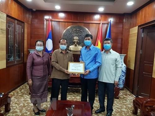 Lào chung sức cùng Việt Nam trong cuộc chiến chống dịch COVID-19  - ảnh 1