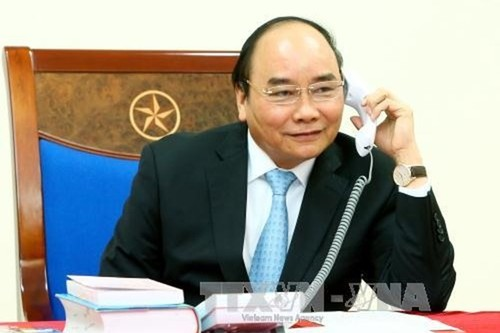 PM encourages Vietnam football team ahead of AFC Asian Cup quarterfinal match  - ảnh 1