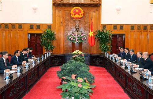 Thủ tướng Nguyễn Xuân Phúc tiếp Bộ trưởng Kế hoạch và Đầu tư Lào - ảnh 1