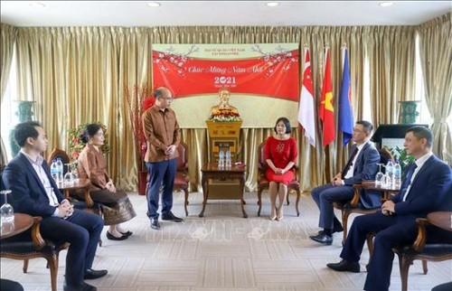 Đại sứ quán Lào chúc Tết Đại sứ quán Việt Nam tại Singapore - ảnh 1