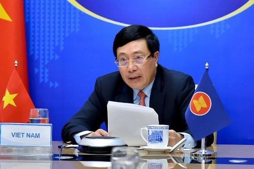 Việt Nam cam kết cùng các nước ASEAN hợp tác đẩy lùi đại dịch Covid-19 - ảnh 2