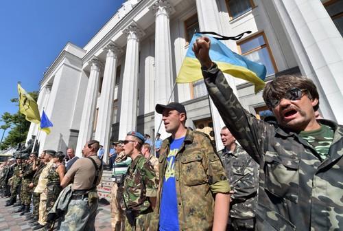 Rusia, Francia y Alemania buscan salida para la crisis en Ucrania - ảnh 1