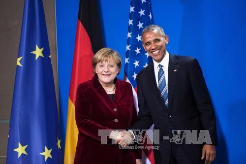 Obama conversa telefónicamente con Merkel antes de abandonar la Casa Blanca  - ảnh 1