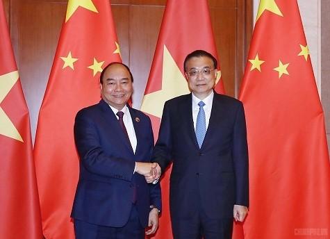 Thủ tướng Nguyễn Xuân Phúc hội đàm với Thủ tướng Trung Quốc - ảnh 1