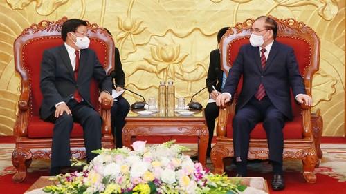 Tổng Bí thư, Chủ tịch nước Lào Thongloun Sisoulith gặp nguyên Tổng Bí thư Nông Đức Mạnh và nguyên Chủ tịch nước Trần Đức - ảnh 1