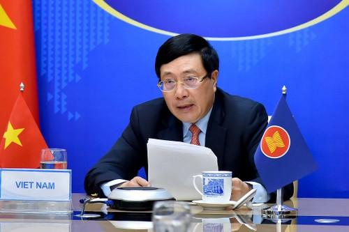 Вьетнам обязался взаимодействовать с другими странами АСЕАН в борьбе с Covid-19 - ảnh 1