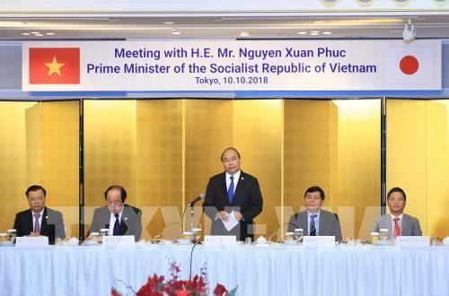 Thủ tướng Nguyễn Xuân Phúc tọa đàm với doanh nghiệp Nhật Bản, tiếp Chủ tịch Ngân hàng MUFJ, Chủ tịch Công ty Mitsubishi và Chủ tịch JETRO - ảnh 1