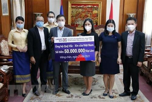 Cộng đồng người Việt tại Lào tiếp tục ủng hộ cuộc chiến chống dịch COVID-19 tại quê nhà - ảnh 1