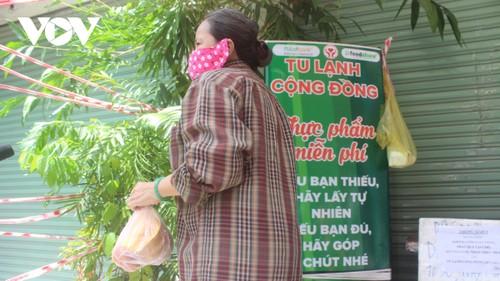 Los habitantes de Ciudad Ho Chi Minh unidos para vencer el covid-19 - ảnh 2