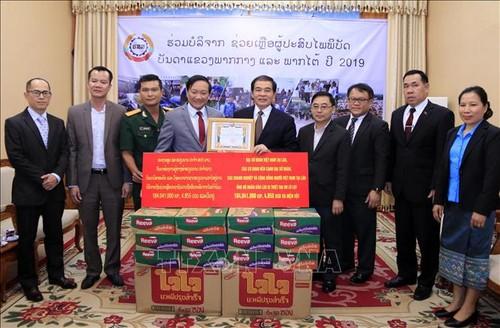 Lào tiếp nhận hỗ trợ của cộng đồng người Việt tại Lào giúp người dân vùng thiên tai - ảnh 1