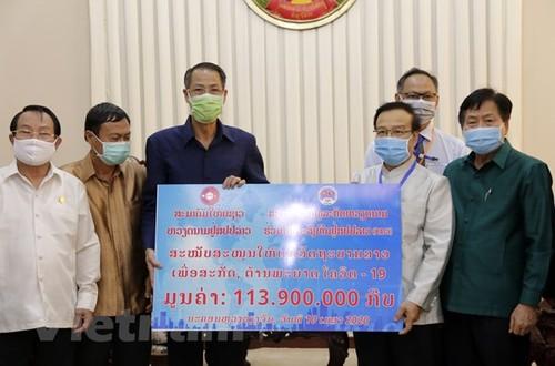 Cộng đồng người Việt chung tay chống dịch bệnh cùng Chính phủ và nhân dân Lào - ảnh 1