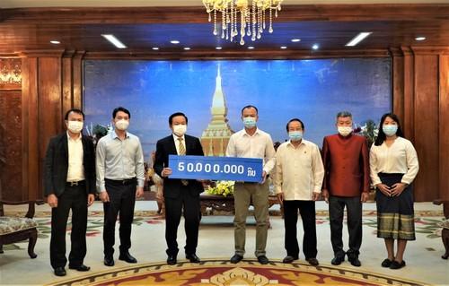 Thủ đô Vientiane (Lào) chia sẻ khó khăn với thành phố Hà Nội và Thành phố Hồ Chí Minh chống dịch COVID-19 - ảnh 1