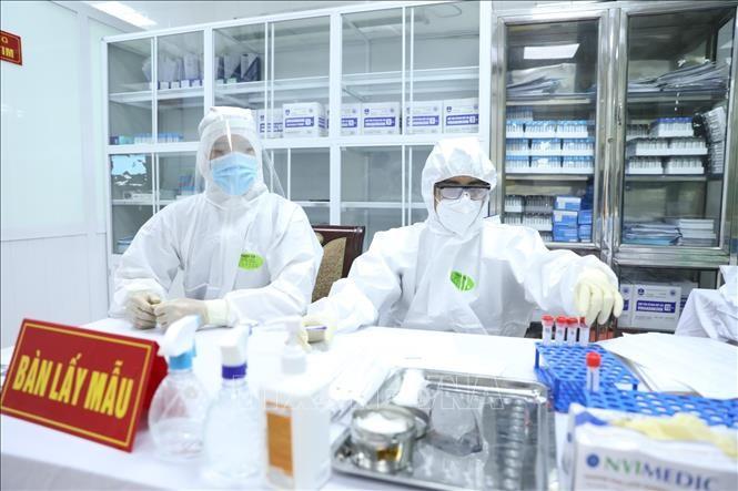Buscan voluntarios para los segundos ensayos de la vacuna vietnamita anticovid-19  - ảnh 1