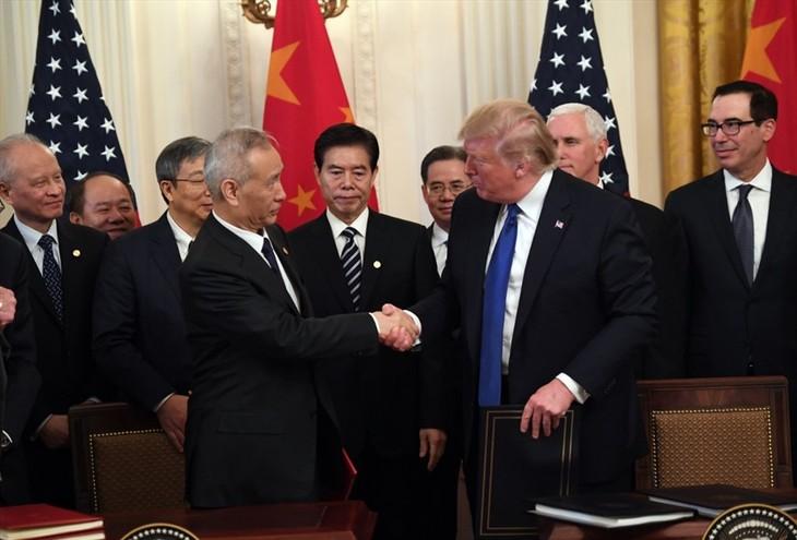 中美承诺继续落实中美第一阶段经贸协议 - ảnh 1