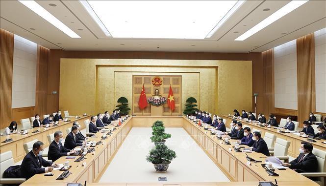 范明政会见中国国务委员兼外交部长王毅 - ảnh 1