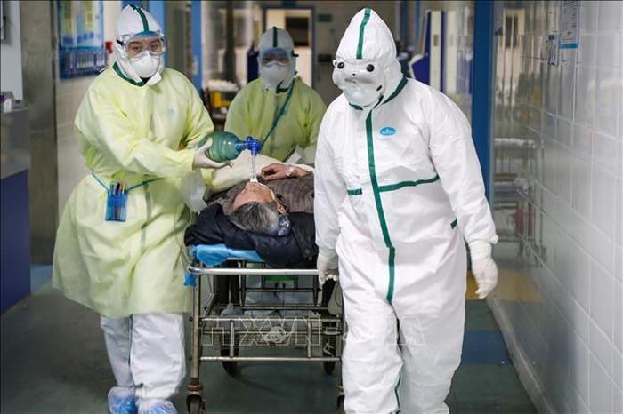 Covid-19: la Chine signale 889 nouveaux cas confirmés et 118 nouveaux décès - ảnh 1