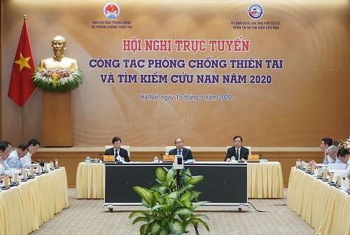Nguyên Xuân Phuc préside une visoconférence sur la prévention contre les catastrophes naturelles et le sauvetage - ảnh 1