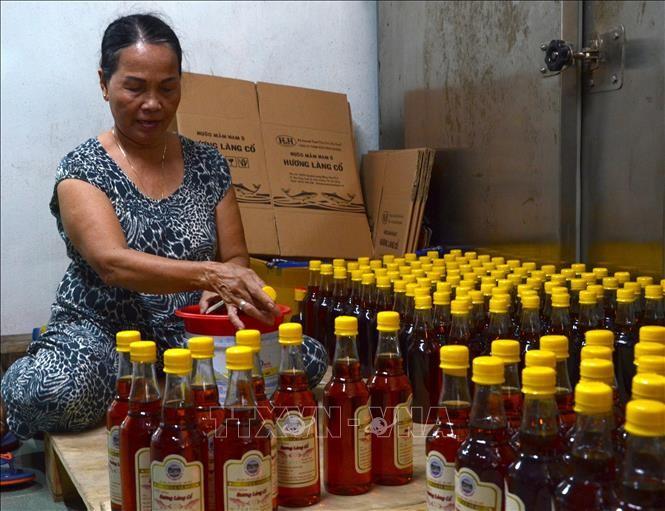 Le nuoc mam de Nam O, premier produit culinaire inscrit au patrimoine national - ảnh 1