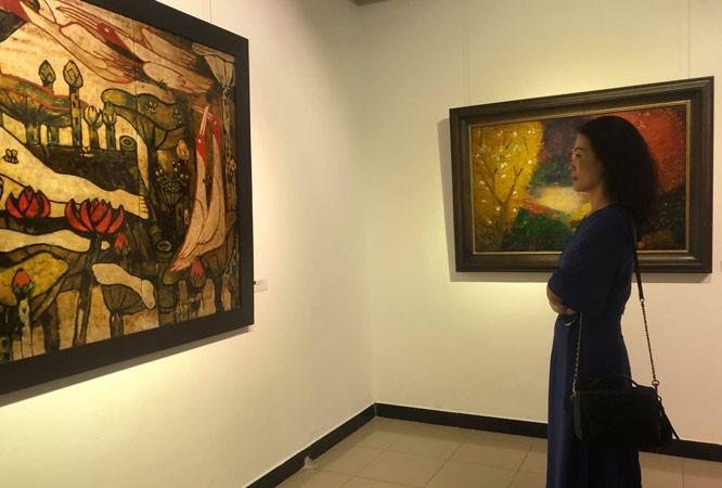 Ausstellung der Lackbilder in Hanoi - ảnh 1