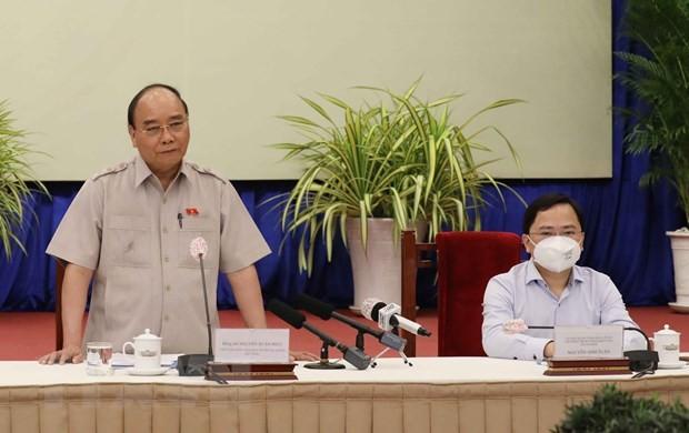 Staatspräsident: vietnamesische Unternehmen solidarisieren sich, um Schwierigkeiten zu überwinden - ảnh 1