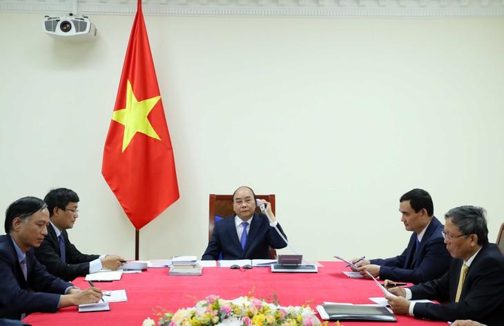 Vietnam-Malaisie: Conversation téléphonique des Premiers ministres - ảnh 1