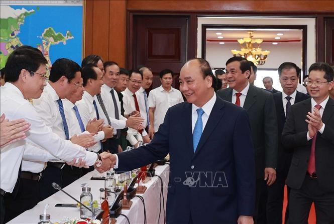 Le président Nguyên Xuân Phuc travaille dans le Centre du pays - ảnh 1