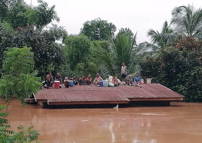 Вьетнам готов содействовать Лаосу ликвидировать последствия разрушения дамбы  - ảnh 1