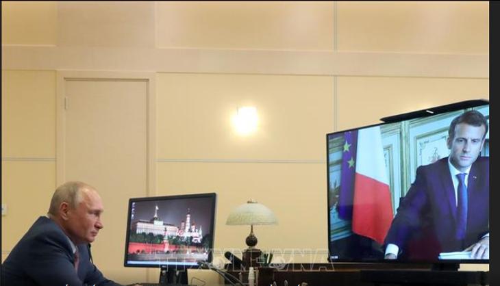 Путин и Макрон провели переговоры в режиме видеоконференции   - ảnh 1