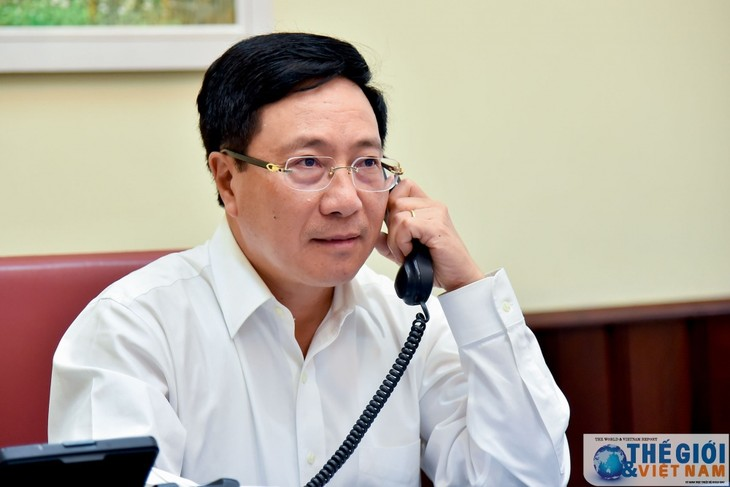Вице-премьер, глава МИД Вьетнама Фам Бинь Минь провел телефонный разговор с главой МИД Республики Корея - ảnh 1