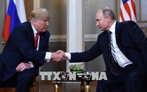 Presiden Rusia dan AS akan mengadakan pertemuan pendek di Perancis - ảnh 1