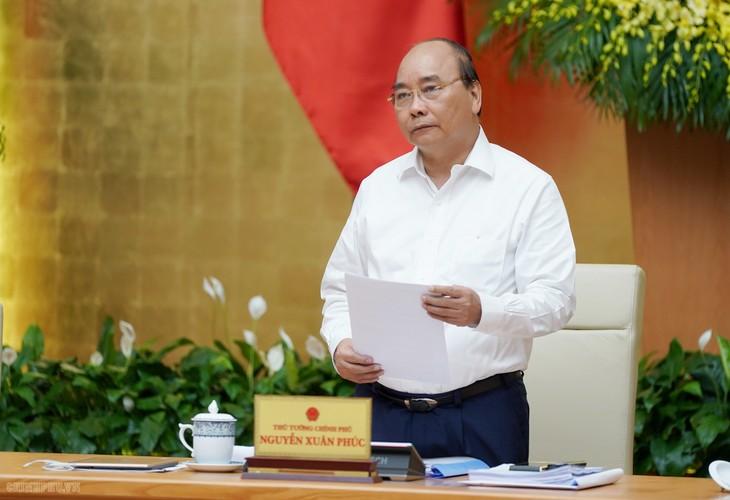 PM Nguyen Xuan Phuc menegaskan bahwa situasi sosial-ekonomi mencapai banyak hasil positif - ảnh 1