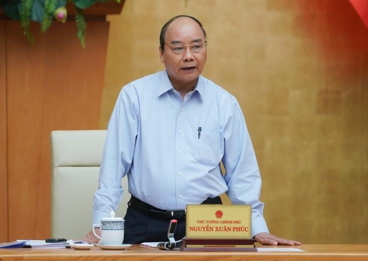 PM Nguyen Xuan Phuc memimpin sidang tentang opsi mengekspor beras - ảnh 1
