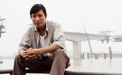 Pelukis Vu Thai Binh: meniupkan jiwa pada kertas do - ảnh 1