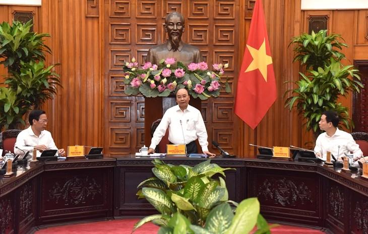 PM Nguyen Xuan Phuc melakukan sidang kerja dengan pimpinan teras Provinsi Ben Tre - ảnh 1