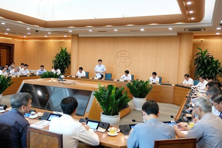Sidang kerja antara Kementerian Kesehatan Vietnam dan Komite Rakyat Kota Ha Noi untuk membahas langkah-langkah mencegah dan memberantas wabah Covid-19 - ảnh 1