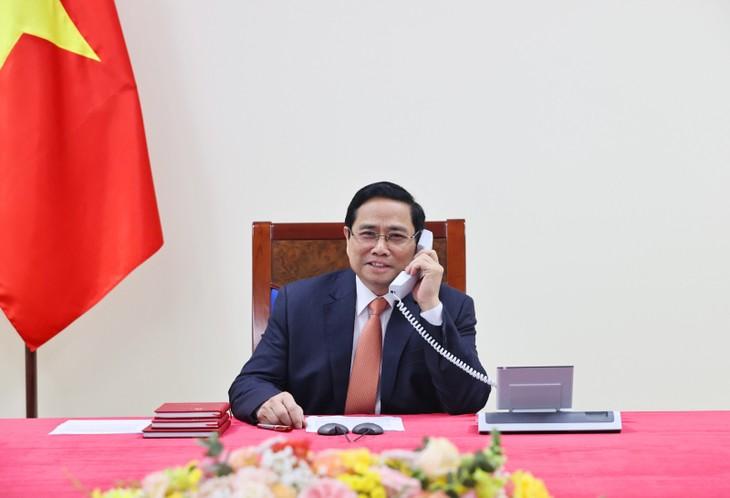 Vietnam dan Singapura Perkuat Pertukaran dan Kerjasama Dalam Kendalikan Wabah Covid-19 - ảnh 1